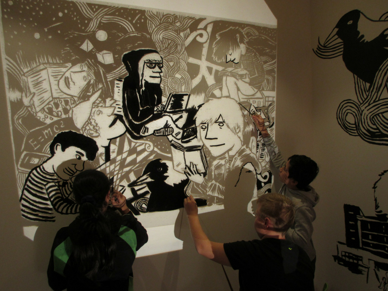 comic artists at work on walls